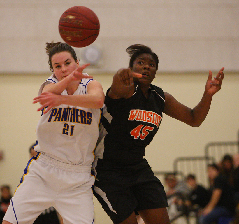 . Presentation\'s Maeve Kavanagh breaks up a pass to Woodside\'s Tiana Williams in the third quarter during the CCS Division II girls basketball finals at Santa Clara High School in Santa Clara, Calif. on Friday, March 1, 2013. The Presentation Panthers beat the Woodside Wildcats, 49-34. (Jim Gensheimer/Staff)