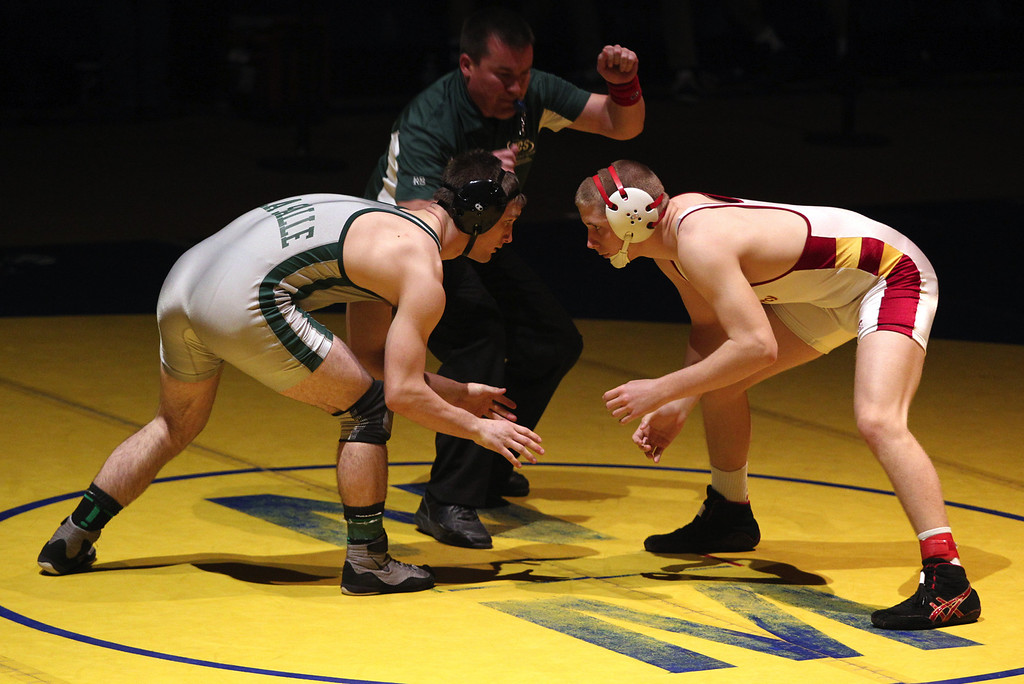 . De La Salle\'s Aaron Pease, left, faces off against Liberty\'s Tanner Blank in the 170-pound finals at the North Coast Section wrestling championships held at Newark Memorial High School in Newark, Calif., on Saturday, Feb. 23, 2013. Pease would get the win. (Anda Chu/Staff)