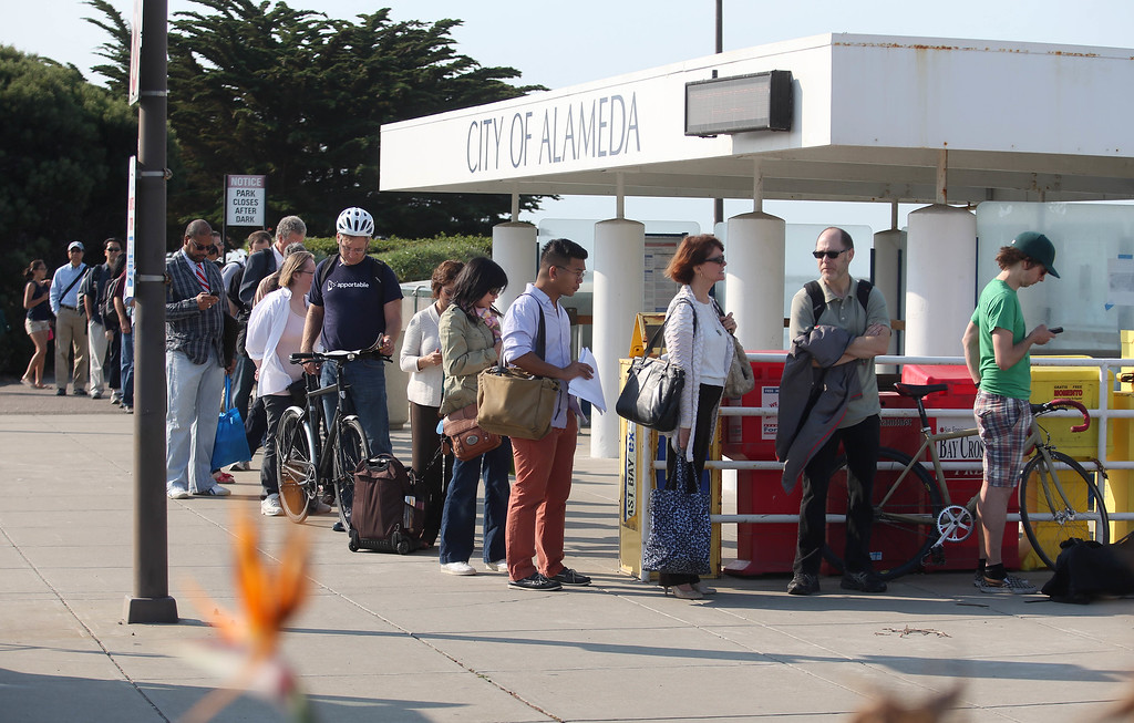 . Traffic backs up along Interstate 580 westbound in Oakland, Calif., on Tuesday, July 2, 2013. The BART strike is in its second day and bargaining talks have not resumed. (Jane Tyska/Bay Area News Group)Commuters board the San Francisco Bay Ferry in Alameda, Calif., on Tuesday, July 2, 2013. The BART strike is in its second day and bargaining talks have not resumed. (Jane Tyska/Bay Area News Group)