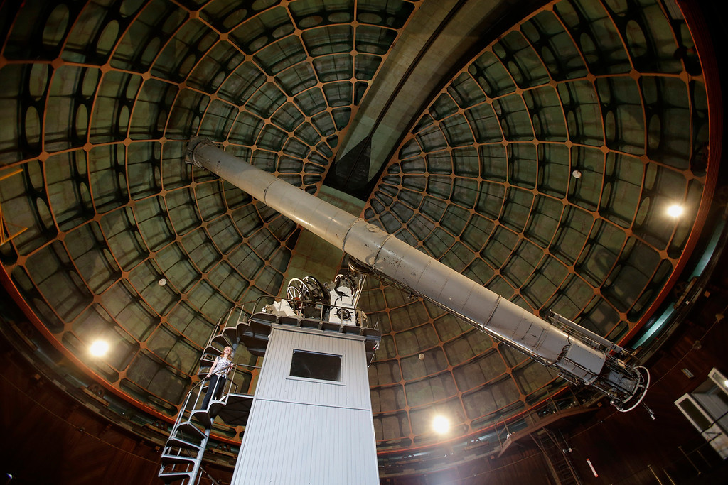 """. Astronomer Elinor Gates stands on the tower beneath the 36\"""" Refractor telescope at Lick Observatory east of San Jose, Calif. on Wednesday, May 8, 2013. The observatory will be celebrating its 125th anniversary.  (Gary Reyes/ Bay Area News Group)"""