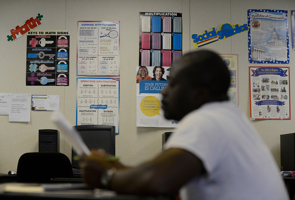 . Edward Sseguya, of Antioch, takes his GED math practice test while attending a six week GED summer class at the Pittsburg Adult Education Center in Pittsburg, Calif. on Monday, June 24, 2013. The GED, is undergoing an overhaul in January, switching to computers, condensing from five tests to four, requiring more analysis and a deeper understanding of math. At the end of December, many students who have begun taking the five tests currently necessary to obtain the certificate are ramping up their efforts, because they\'ll have to start over if they\'re not done by Dec. 31. (Jose Carlos Fajardo/Staff)