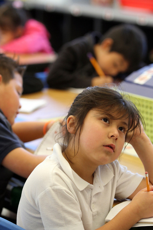 . Second grader Estrella Mendoza is deep in thought about a multiplication problem during class at Peres Elementary School in Richmond, Calif., on Friday, Feb. 8, 2013.  Peres school is one of two elementary schools in Richmond that have raised their average API test scores to over 800. (Laura A. Oda/Staff)