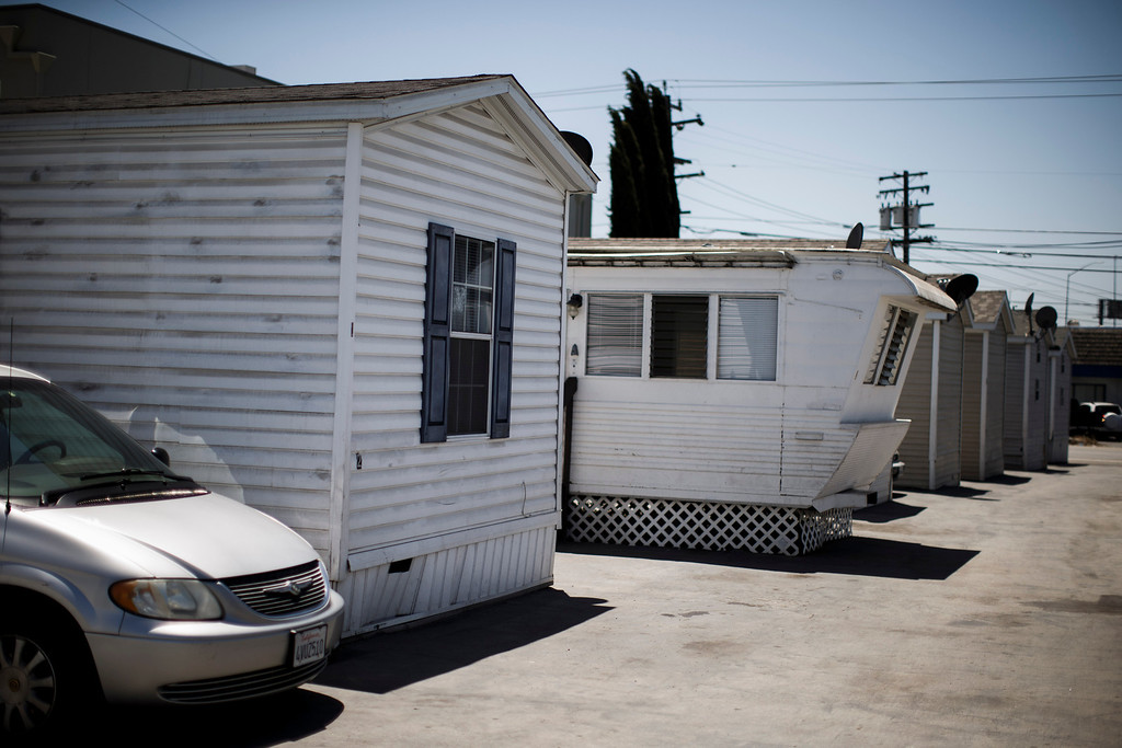 . Clarissa Taitano and her family recently moved into their mobile home, left, after living in a Santa Clara motel for 64 days. (Dai Sugano/Bay Area News Group)