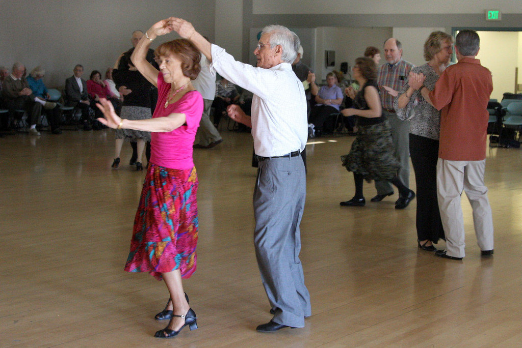 . Jerry Alcorn, left, and John Villarreal, both of Hayward dance to the sounds of the Cool Tones with lead singer, Kathy Blackburn at the Pleasanton Senior Center\'s 20th anniversary celebration tea dance in Pleasanton, Calif. on Sunday, March 3, 2013.  (Jim Stevens/Staff)