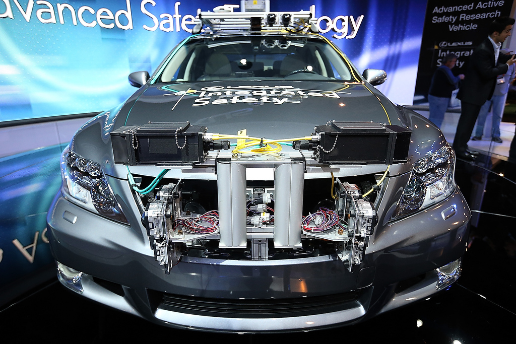 . A Lexus LS Integrated Safety self-driving car is displayed at the Lexus booth during the 2013 International CES at the Las Vegas Convention Center on January 8, 2013 in Las Vegas, Nevada. (Photo by Justin Sullivan/Getty Images)