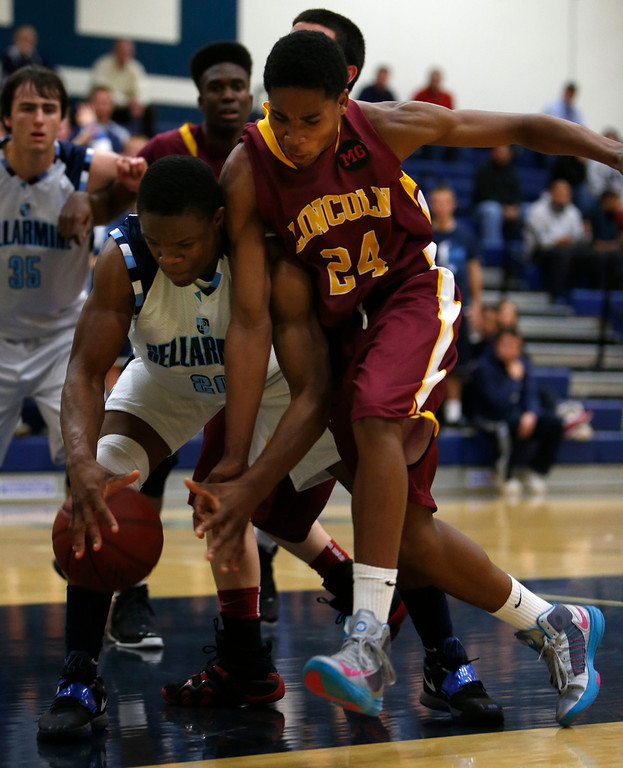 . Bellarmine College Preparatory\'s Kenneth Olugbode (20) fights for a loose ball against Lincoln High School\'s Tarrez Blaylock (24) during their NorCal Division I Round 1 game in the third period at Bellarmine College Preparatory in San Jose, Calif., on Wednesday, March 6, 2013.  (Nhat V. Meyer/Staff)