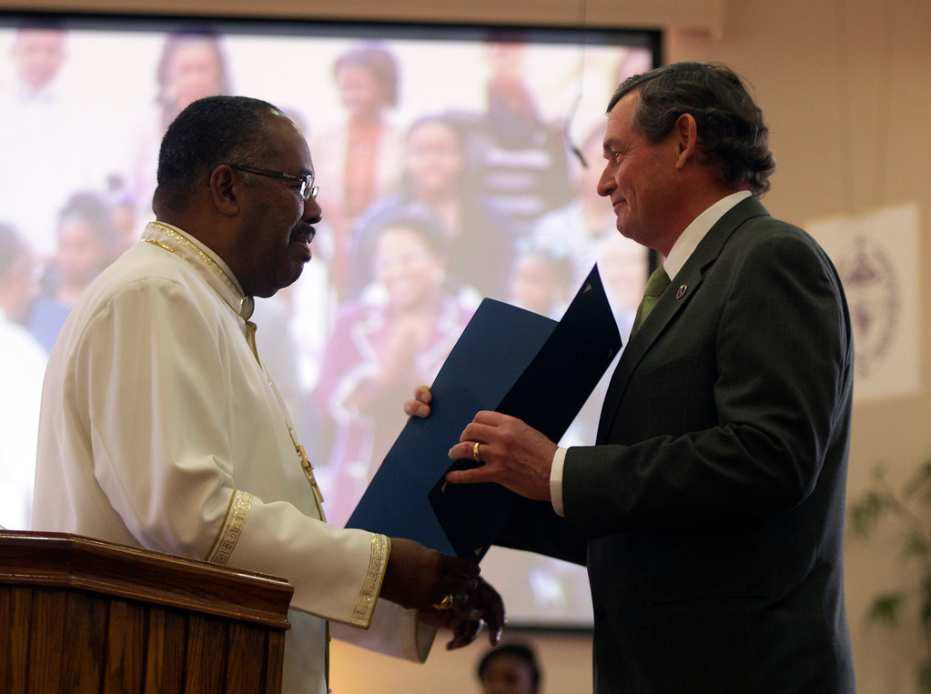 . Bishop J.W. Macklin of Glad Tidings Church of God, left, presents a certificate of honorary membership to California State University Chancellor Timothy White during a service at the church, Sunday, March 10, 2013 in Hayward, Calif. White visited the church as part of the annual Super Sunday event to encourage African Americans to attend college. (D. Ross Cameron/Staff)