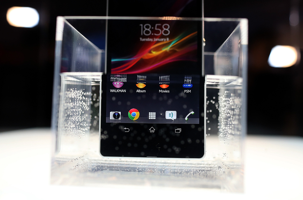 . A Sony Xperia Z smart phone is seen submerged in water in the Sony booth during the 2013 International CES at the Las Vegas Convention Center on January 8, 2013 in Las Vegas, Nevada. (Photo by Justin Sullivan/Getty Images)