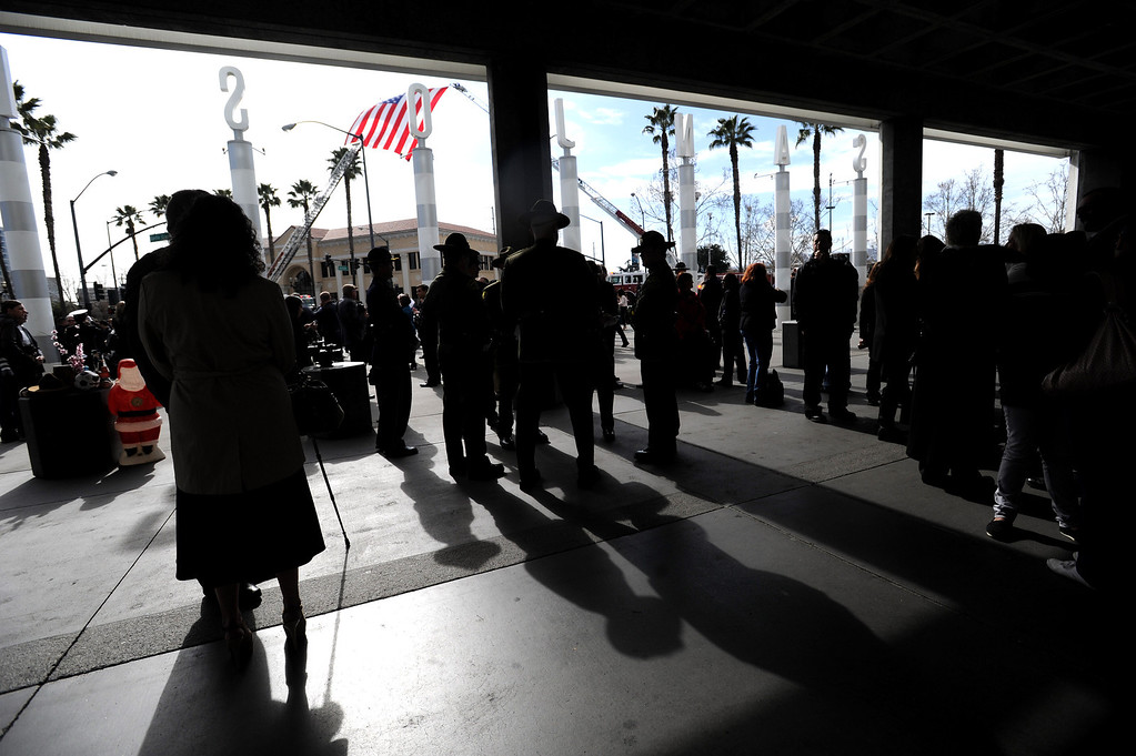 ". People wait to enter the HP Pavilion in San Jose, Calif., on Thursday, March 7, 2013. Thousands are at the pavilion to mourn the loss of Santa Cruz police officers Loran ""Butch\"" Baker and Elizabeth Butler, who lost their their lives in the line of duty on Feb. 26. (Dan Honda/Bay Area News Group)"