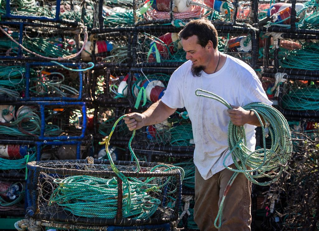 . Fisherman Jarid Rold, 38, gets crab pots ready at Pillar Point Harbor .(John Green/Bay Area News Group)