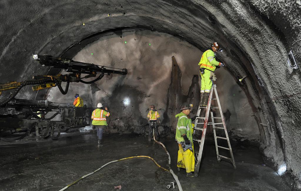 . Caltrans contractors from Tudor-Salida work near the face of the Caldecott Tunnel excavation 1200 feet into the Berkeley hills near Orinda, California Monday March 28, 2011.   (Karl Mondon)