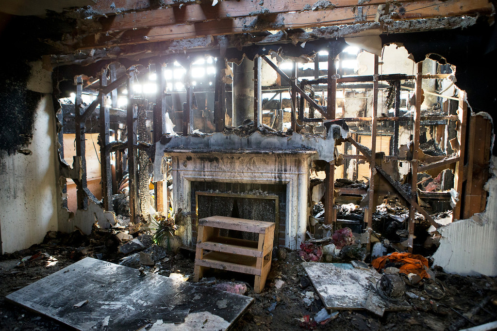 . A view of Anna Paasi and Uatesoni Paasi\'s garage, where the fire that destroyed their house in December started, in San Mateo, Calif. on Thursday, Jan. 2, 2014.  (LiPo Ching/Bay Area News Group)