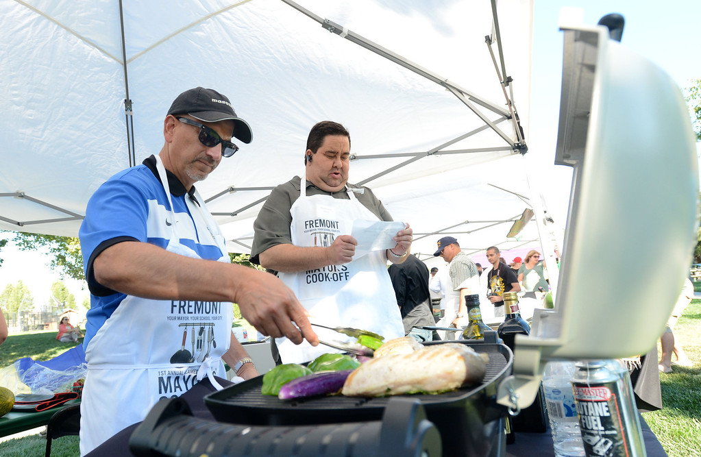 """. Chef Bill Reneti Massimo, left, with Fremont\'s Massimo\'s restaurant and Fremont Mayor Bill Harrison, prepare meals during the \""""Alameda County Mayors\' Healthy Cook-Off Challenge\"""" held at the Dublin Farmers\' Market at Emerald Glen Park in Dublin, Calif., on Thursday, July 25, 2013. The winners advanced to compete against the winners of the Contra Cost County Mayors\' Healthy Cook-Off Challenge. The contest will be held at Mt. Diablo High School in the fall. The cook-off was presented by Concord\'s Wellness City Challenge and promotes the importance of healthy eating. (Doug Duran/Bay Area News Group)"""