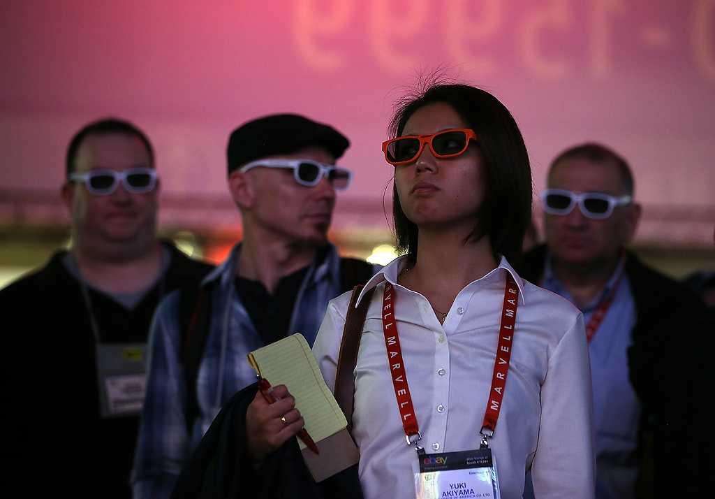 . Attendees wear 3-D glasses to watch a presentation at the LG booth during the 2013 International CES at the Las Vegas Convention Center on January 8, 2013 in Las Vegas, Nevada. (Photo by Justin Sullivan/Getty Images)
