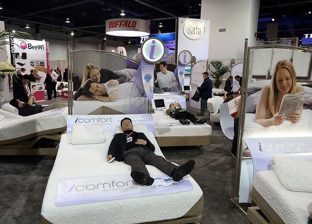 . An attendee rests on a Sealy iComfort bed during the 2013 International CES at the Las Vegas Hilton on January 9, 2013 in Las Vegas, Nevada. (Photo by Justin Sullivan/Getty Images)