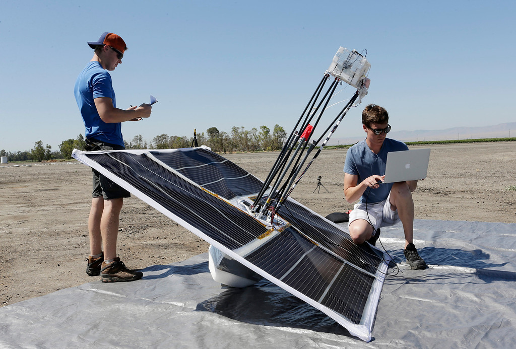 . T.J. Tierney and Michael Margraf of the Project Loon team from Google make their final preparations to launch a high-altitude balloon carrying electronic testing equipment into the skies above Dos Palos, Calif. on July 26, 2013. The test launch is part of the research being done by the Google X division to create a high-altitude transponder network that will provide internet access to underserved areas of the world.  (Gary Reyes/Bay Area News Group)