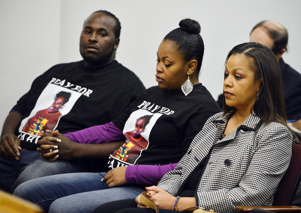 . Nailah Winkfield, center, mother of Jahi McMath, is flanked by Sandra Chatman, Jahi\'s grandmother, right, and Martin Winkfield during a court hearing to discuss the treatment of Jahi in Oakland, Calif. on Monday, Dec. 23, 2013. Jahi, 13, remains on a ventilator at Children\'s Hospital after suffering tragic complications during surgery. (Kristopher Skinner/Bay Area News Group)
