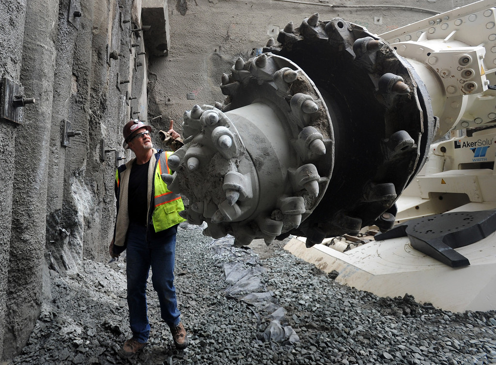 . The giant teeth of a 130-ton roadheader took its first ceremonial bite of the East Bay hills during ceremonies commemorating the start of tunneling at the Caldecott Tunnel fourth bore project near Orinda, Calif. Monday August 9, 2010.    (Karl Mondon/Staff)