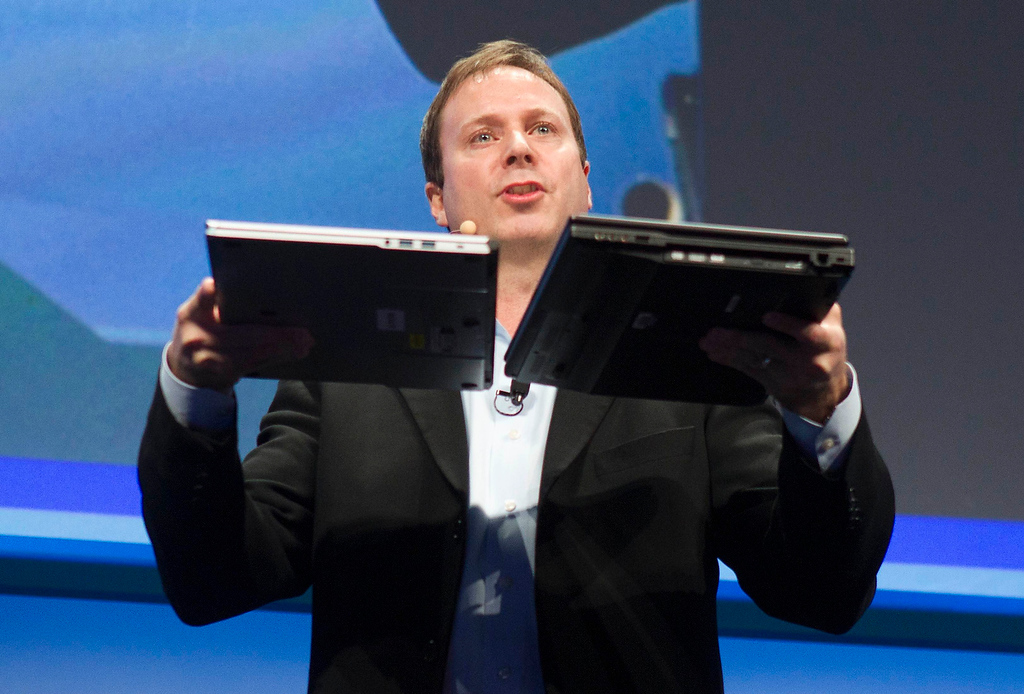". Kirk Skaugen, Intel\'s vice president of PC client group, compares the thickness of a new NEC Ultrabook (12.8mm thick) and a three-year-old laptop at an Intel news conference during the Consumer Electronics Show (CES) in Las Vegas January 7, 2013. Intel announced improvements to its processors including one with ""all day\"" battery life. Intel also announced the availability of live and on-demand pay TV content to Intel devices. (REUTERS/Steve Marcus)"