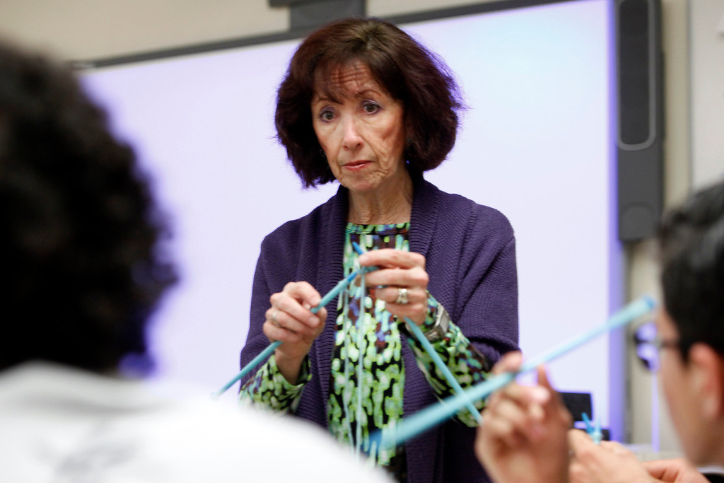 . Patty Giorgianni, an art teacher at Oak Grove HIgh School, instructs her second period class Thursday, Feb. 28, 2013 in San Jose, Calif. Giorgianni, like most teachers, has had to be creative in finding ways to provide supplies for her students. For knitting projects, she provides yarn from the Resource Area For Teaching, which gathers recycled materials from businesses and repurposes them for classrooms. (Karl Mondon/Staff)