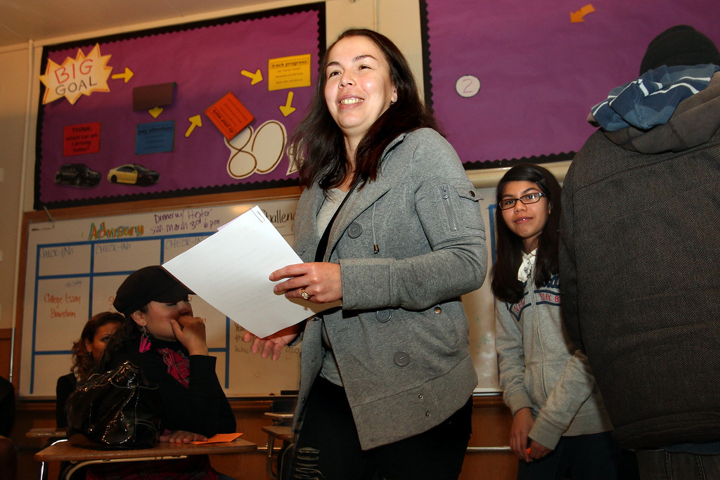. Leticia Lopez, left, followed by her daughter Jayra Revuelta, 13,  are all smiles after her daughter enrolled in Richmond Leadership Public High School through a lottery process in Richmond., Calif., on Thursday, Feb. 28, 2013.  The charter school registered 250 students but only 120 were accepted, including 50 of them because they have siblings currently enrolled.  (Ray Chavez/Staff)