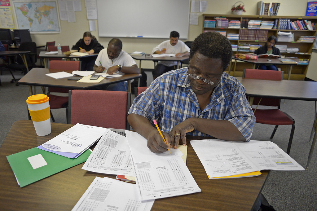 . Philip Yega, of Antioch, spreads out and takes a GED practice test while attending a six week GED summer class at the Pittsburg Adult Education Center in Pittsburg, Calif. on Monday, June 24, 2013. The GED, is undergoing an overhaul in January, switching to computers, condensing from five tests to four, requiring more analysis and a deeper understanding of math. At the end of December, many students who have begun taking the five tests currently necessary to obtain the certificate are ramping up their efforts, because they\'ll have to start over if they\'re not done by Dec. 31. (Jose Carlos Fajardo/Staff)