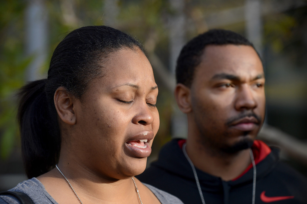 . Nailah Winkfield, left, speaks to the media about her daughter Jahi in front of Oakland\'s Children\'s Hospital in Oakland, Calif., on Tuesday, Dec. 17, 2013. Jahi McMath, 13, was declared brain dead following complications from a three-part surgery to remove her tonsils and clear tissue from her nose and throat to treat her sleep apnea and other health issues.  (Dan Honda/Bay Area News Group)