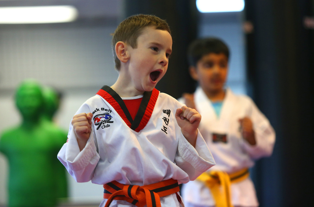 . Sammy Masek, 6, lets out a yawn during martial arts class on Monday, Feb. 11, 2013 in Pleasanton, Calif.  Masek is one of a growing number of children that have lost their diagnosis of autisim.  (Aric Crabb/Staff)