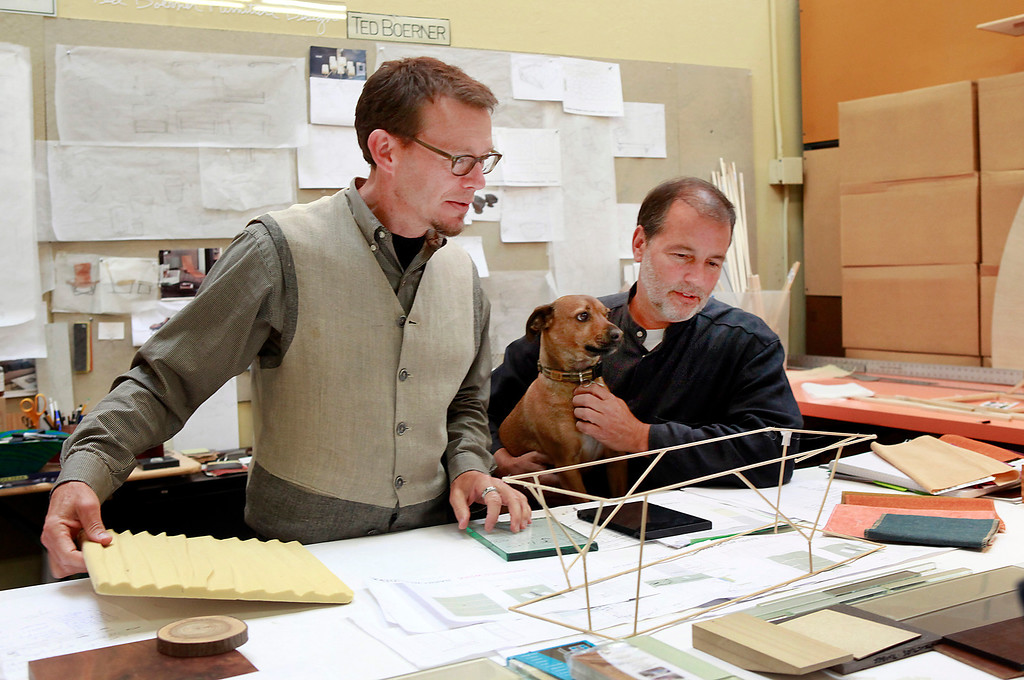 . Ted Boerner, left, and Frank Pontes founded Ted Boerner, Inc., 20 years ago. The San Francisco design studio creates innovative, custom furniture and are featured in showrooms around the country as well as his own NYC showroom.  They work on a new coffee table design Wednesday, July 10, 2013 in San Francisco, Calif., with the assistance of their dog, Nemo. (Karl Mondon/Bay Area News Group)
