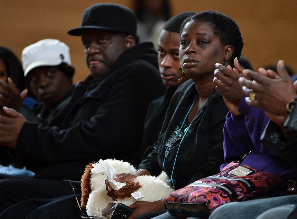 . Dinyal New, right, mother of slain teenager Lee Weathersby III, listens to a speaker during a memorial service for her son held at Alliance Academy in Oakland, Calif. on Wednesday, Jan. 8, 2014. (Kristopher Skinner/Bay Area News Group)