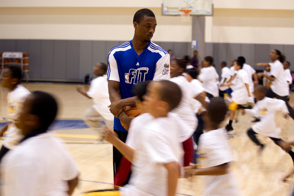 . Golden State Warriors forward Harrison Barnes, top, watches as a group of children perform drills while participating in a basketball clinic at the Warriors practice facility in downtown Oakland, Calif., Wednesday, Jan. 30, 2013. The Warriors and Kaiser Permanente hosted the event as part of the NBA FIT Live Healthy Week. (D. Ross Cameron/Staff)