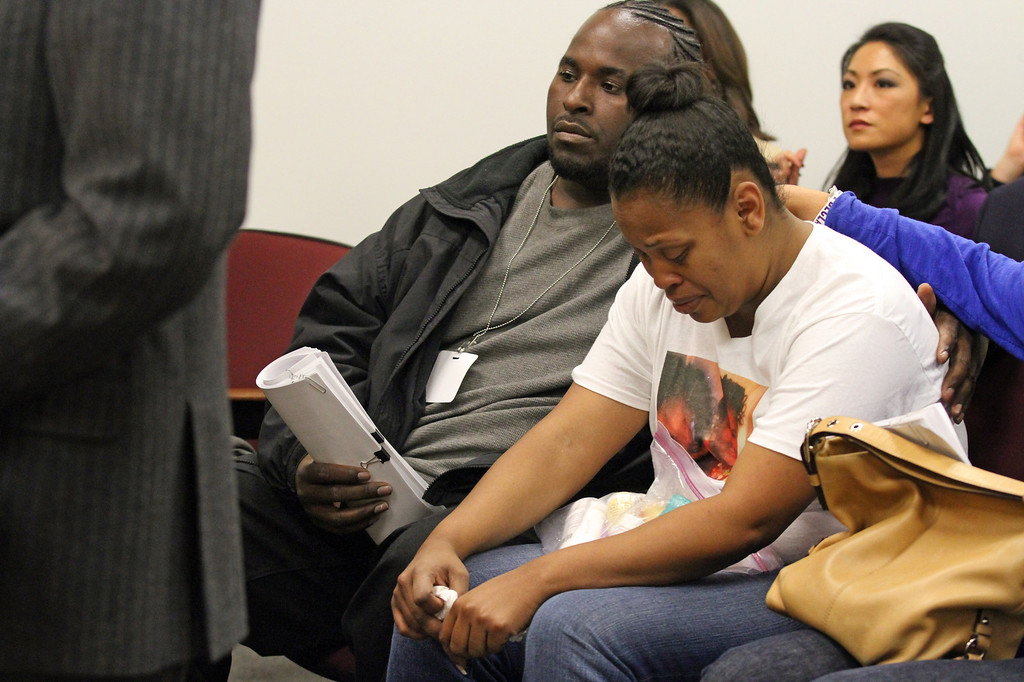. Nailah Winkfield, mother of 13-year-old Jahi McMath, is comforted by her husband Martin Winkfield, left, and another family member as they wait for a hearing to start in Department 31 in the Post Office Building in Oakland, Calif., on Friday, Dec. 20, 2013. The family was asking the court for a restraining order against Children\'s Hospital to ensure that Jahi is not taken off a ventilator until they are ready. (Laura A. Oda/Bay Area News Group)