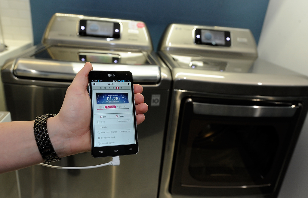 . LG\'s smart wash and dryer with Smart ThinQ technology are seen at the 2013 International CES at the Las Vegas Convention Center on January 8, 2013 in Las Vegas, Nevada. The home appliance is able to communicate with the user\'s smartphone. (Photo by David Becker/Getty Images)