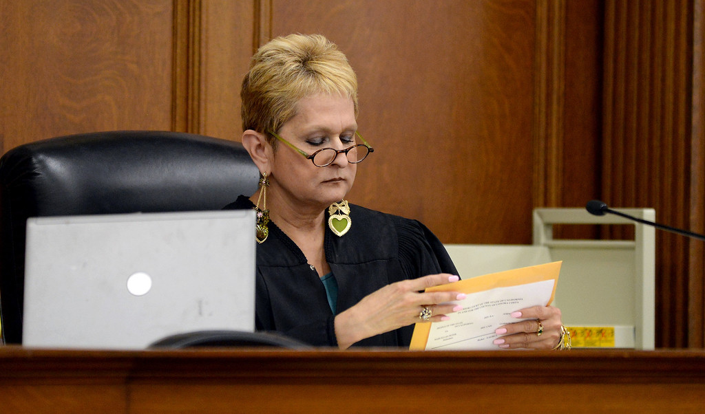 . Judge Barbara Zuniga opens one of the envelopes containing a verdict at the Wakefield-Taylor courthouse in Martinez, Calif., on Thursday, July 18, 2013. Two separate verdicts were read in the Richmond High gang rape trials Marcelles Peter and Jose Montano with Judge Barbara Zuniga presiding. Juries in both cases brought back guilty verdicts. (Dan Honda/Bay Area News Group)