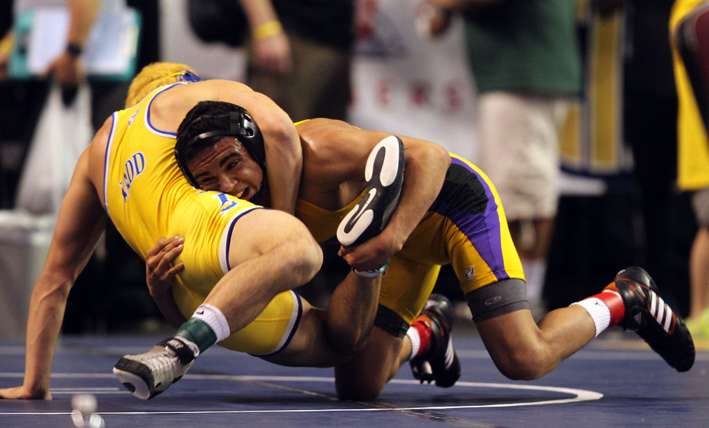 . Riordan\'s Zac Contreras, right, wrestles Clovis\' Jason Ladd in a 145-pound consolation round match during the California Interscholastic Federation wrestling championships in Bakersfield, Calif., on Saturday, March 2, 2013. Contreras would go onto win the match. (Anda Chu/Staff)