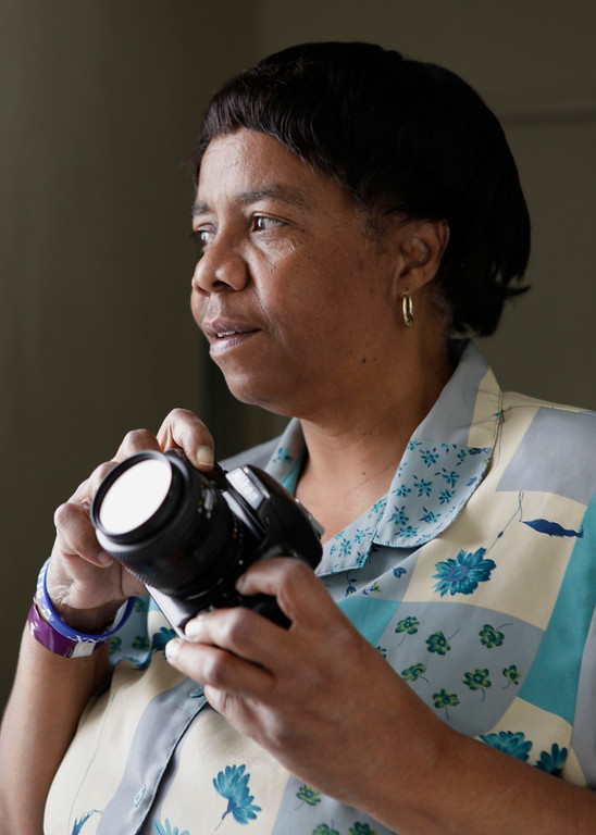 . Sherrie Green is photographed with her camera at her Santa Clara, Calif. home on Thursday, June 14, 2012.  Green was a budding photojournalist in the 1990s when she began a project to make portraits of prominent African-American leaders in Monterey County. The project resulted in a series of 28 color portraits. She hopes to one day give the images to the Monterey County Historical Society. A heart attack in September has slowed her efforts to find a permanent home for her portraits but she told the Mercury News she is still seeking a permanent home for them. (Gary Reyes/ Staff)