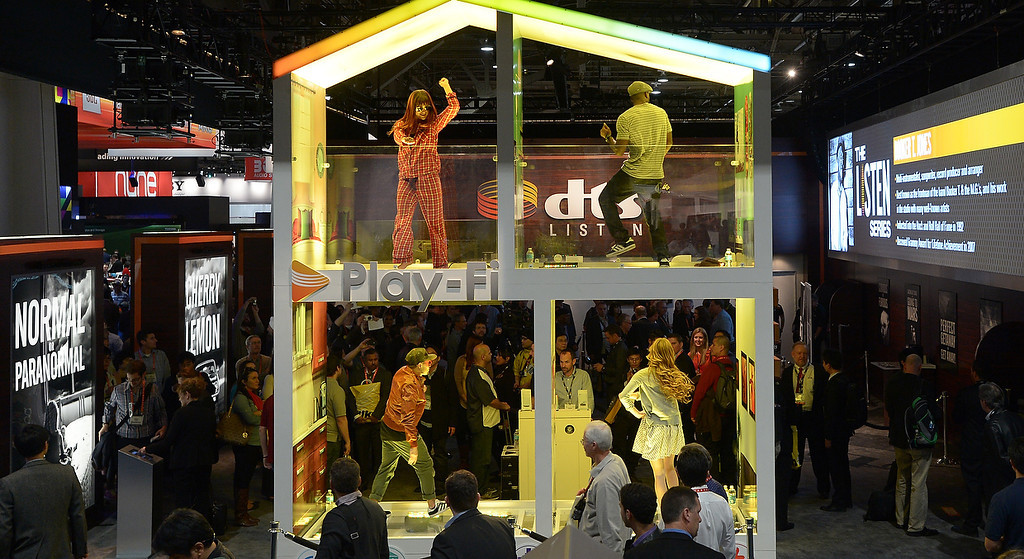 . Dancers entertain visitors at DTS booth at the 2013 International CES at the Las Vegas Convention Center on January 8, 2013 in Las Vegas, Nevada. (JOE KLAMAR/AFP/Getty Images)