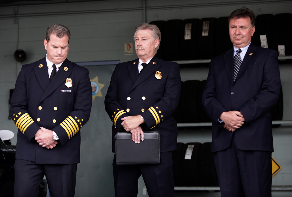 . Michael Keefe, Fire Chief of the Foster City Fire Department , John Mapes, Foster City Fire Department Investigator and Robert Foucrault, San Mateo Coroner, attend a press conference to discuss last Saturday\'s deadly limousine fire at the CHP Headquarters in Redwood City, Calif. on Monday, May 6, 2013. Five woman including a bride died when their limousine became engulfed in flames on the San Mateo Bridge while on their way to a bridal shower. Four women and the driver were able to escape the flames.  (Gary Reyes/ Bay Area News Group)