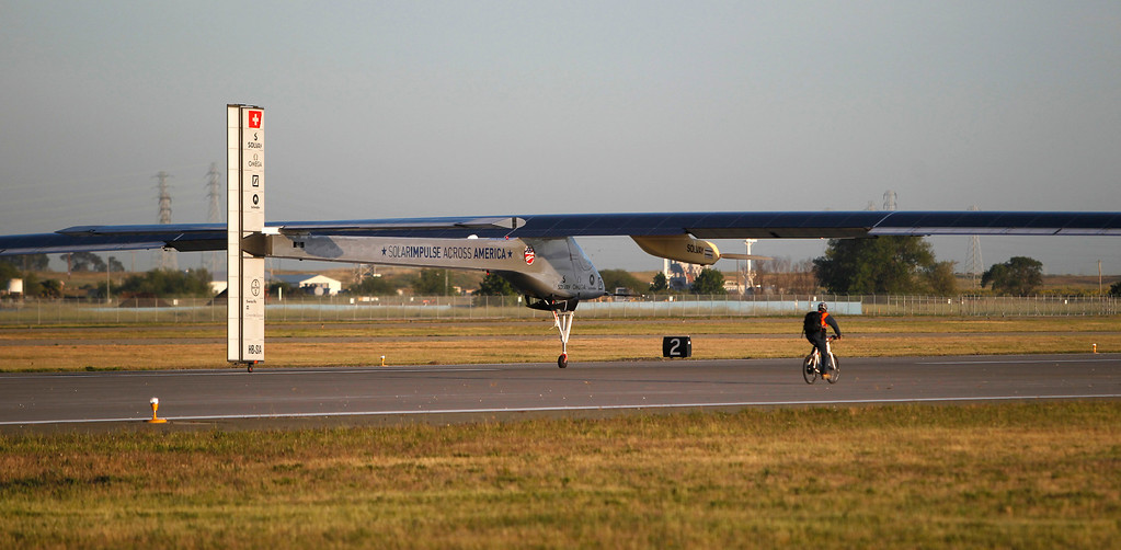 . The Solar Impulse, the experimental airplane, comes in for landing after a test flight at Moffett Airfield in Mountain View, Calif. Friday morning April 19, 2013. (Patrick Tehan/Staff)