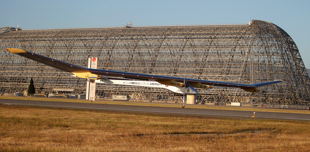 . With Hangar One as a backdrop, the Solar Impulse, the experimental airplane, comes in for landing after a test flight at Moffett Airfield in Mountain View, Calif. Friday morning April 19, 2013. (Patrick Tehan/Staff)
