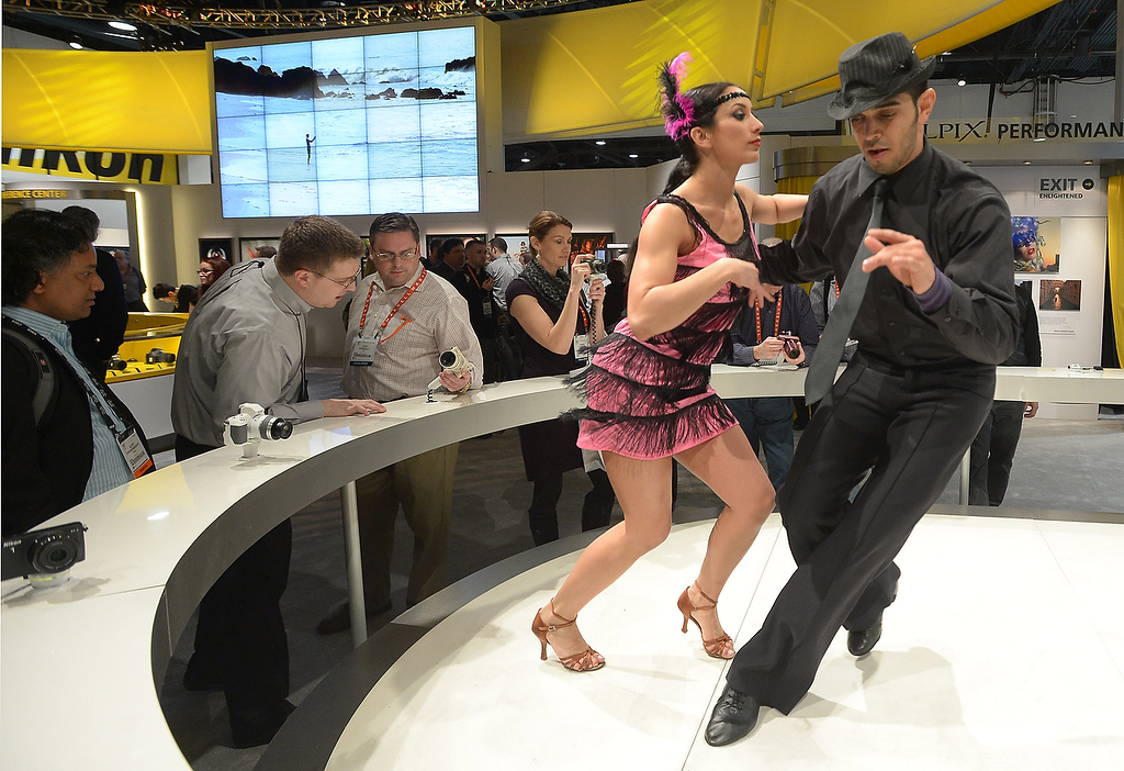. Dancers entertain visitors at Nikon booth at the 2013 International CES at the Las Vegas Convention Center on January 8, 2013 in Las Vegas, Nevada. (JOE KLAMAR/AFP/Getty Images)
