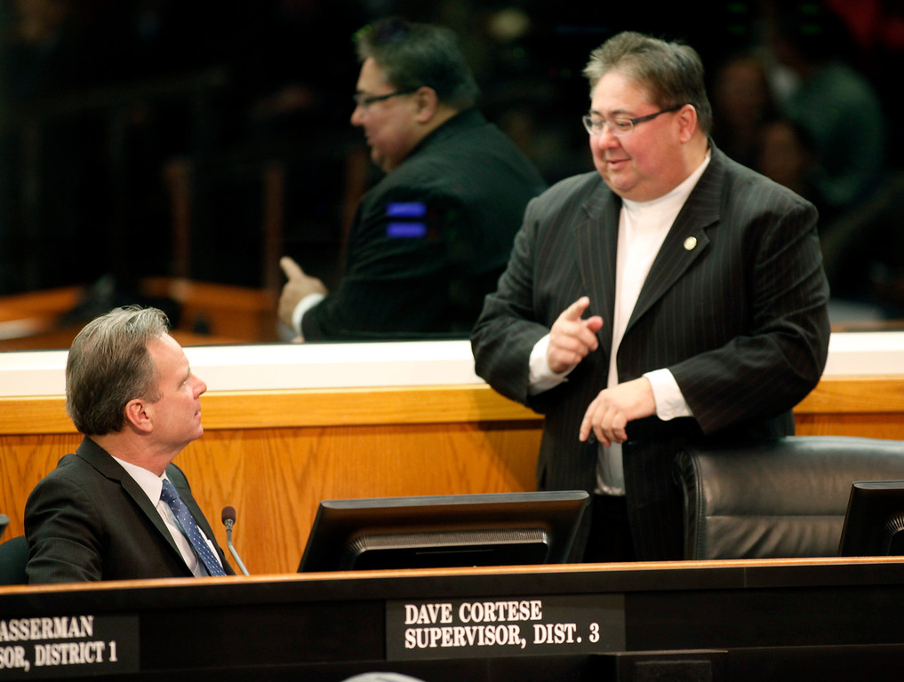 . Supervisor George Shirakawa, Jr. points out the the time to fellow Supervisor Dave Cortese as the start of the 2013 State of the County Address runs tardy on Tuesday Jan. 29, 2013 in San Jose, Calif. (Karl Mondon/Staff)