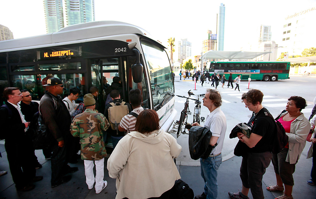 . Reverse commuters wait for to board AC Transit buses headed to Oakland at the downtown transit terminal in San Francisco, Calif., on Monday morning, July 1, 2013, the first day of the BART strike. (Karl Mondon/Bay Area News Group)