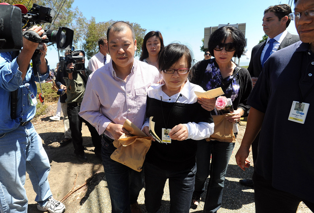 . A couple identified as the parents of Asiana crash victim Ye Mengyuan leave a prayer ceremony for the Asiana Flight victims put on by the Tzu Chi Foundation in Burlingame, Calif., on Saturday, July 13, 2013. Tzu Chi is an international Buddhist relief organization that began in Taiwan and offers compassionate efforts for charity, medical treatment, education and disaster relief.  (Dan Honda/Bay Area News Group)