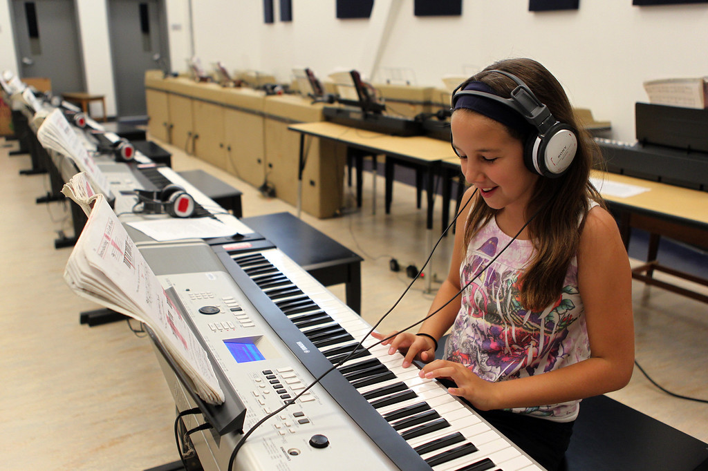 . Mikala Thinger, of Roseville, the daughter of De Anza High School Alum Steve Thinger, not pictured, tries out a keyboard while touring school\'s new campus in Richmond, Calif., on Saturday, Sept. 7, 2013. This is the latest school reconstruction project in the West Contra Costa school district. (Anda Chu/Bay Area News Group)