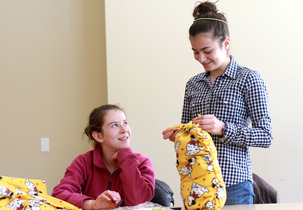 . Volunteers Niki Knauer, 13, left, and Cameron Most, 12, right, make a puppy pillow for the Palo Alto Humane Society during the sixth annual Mitzvah Day for the Martin Luther King Jr. Day of Service at the Palo Alto Jewish Community Center in Palo Alto, Calif., on Monday, Jan. 21, 2013. The annual Mitzvah Day at the community center had volunteers for 27 community projects on and off the campus. (Kirstina Sangsahachart/Staff)