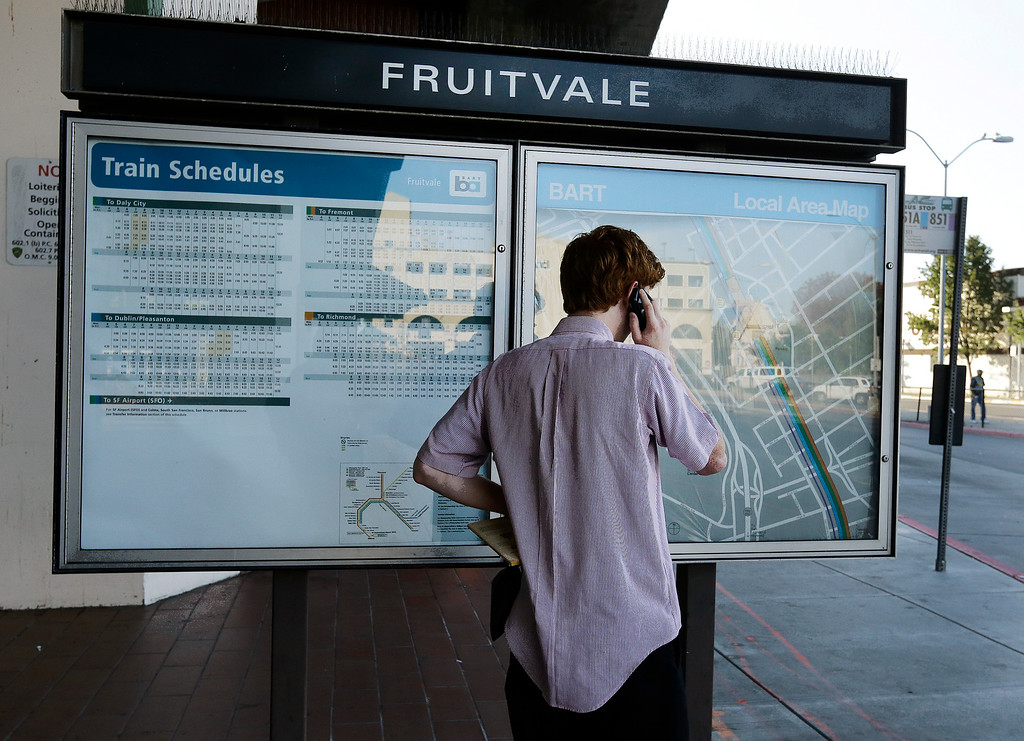 . A man makes a phone call upon learning that the Fruitvale BART station is closed due to a strike Monday, July 1, 2013, in Oakland, Calif. (AP Photo/Ben Margot)