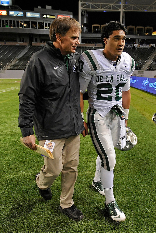 . De La Salle Spartans\' head coach Bob Ladouceur chats with player Tiapepe Vitale (20) before playing the Centennial Huskies in the Open Division during the 2012 CIF State Football Championship at Home Depot Center in Carson , Calif. on Saturday, Dec. 15, 2012. (Jose Carlos Fajardo/Staff)