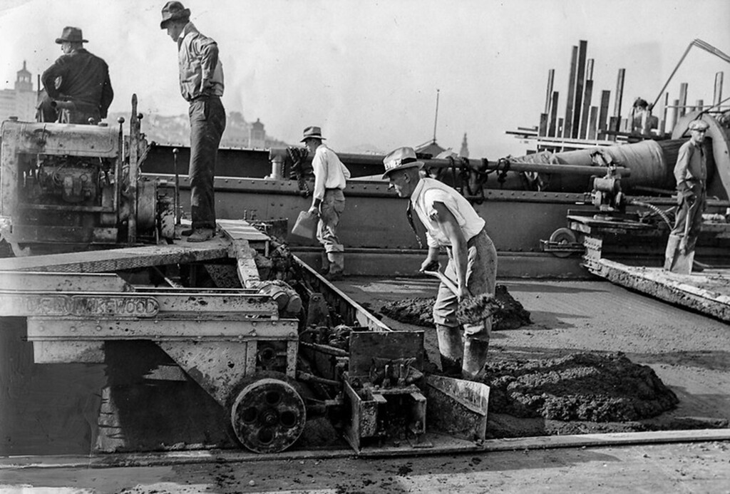 . October 1936 - Workmen pour the concrete paving. (Oakland Tribune Photo)