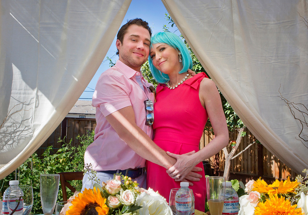. From left, Jeffrey and Jeniffer Lang pose for a portrait at their wedding reception in San Jose, Calif. on Saturday, July 27, 2013.  (LiPo Ching /Bay Area News Group)